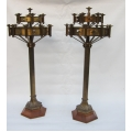 Pair of floor standing candlesticks